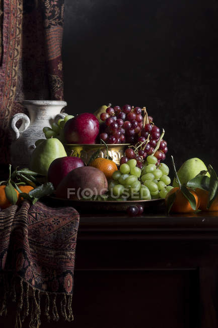 Fruits in vase with pitcher — Stock Photo