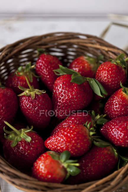 Fresh strawberries in basket — Stock Photo