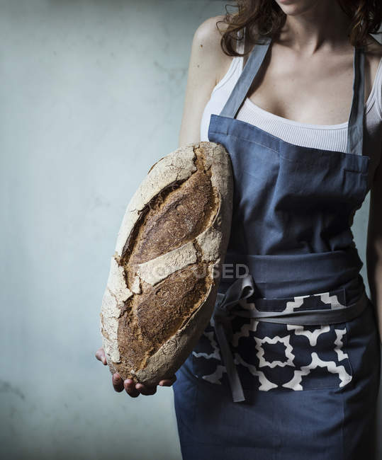 Woman holding loaf of bread — Stock Photo