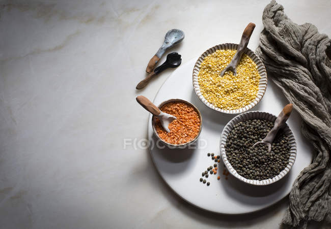 Colorful lentils in ceramic bowls — Stock Photo