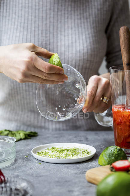 Woman cooking Strawberry Champagne Margarita — Stock Photo