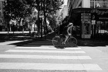 Woman riding on bicycle — Stock Photo