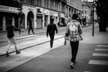 Men walking on street — Stock Photo