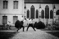 Man and woman fencing - foto de stock