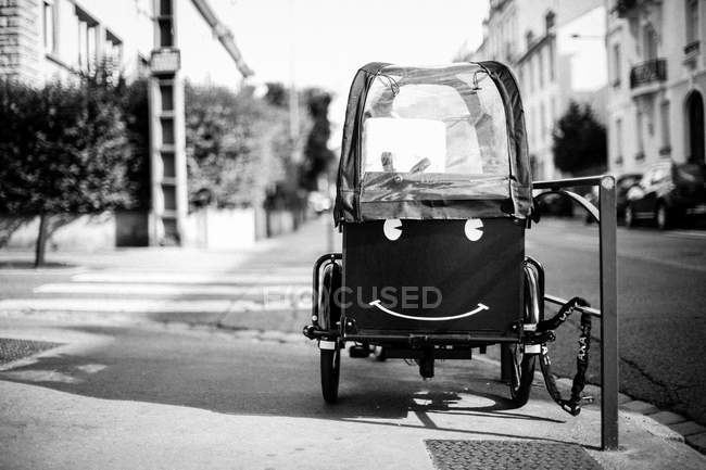 Smiley face on tricycle cabin — Stock Photo