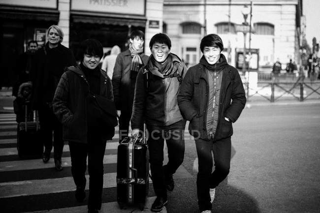Men crossing crosswalk — Stock Photo