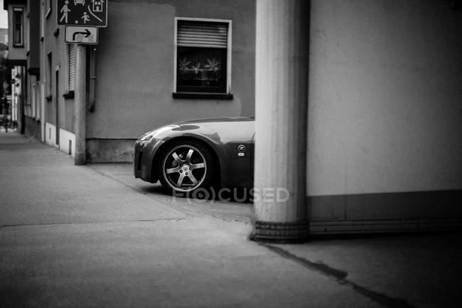 Modern car parked at urban street — Stock Photo
