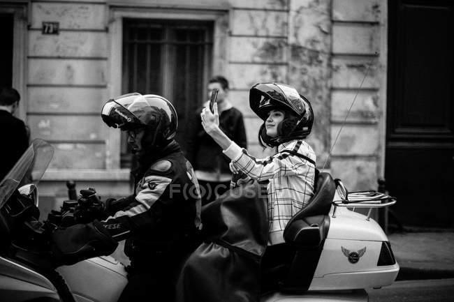 Guest taking selfie on motorbike — Stock Photo