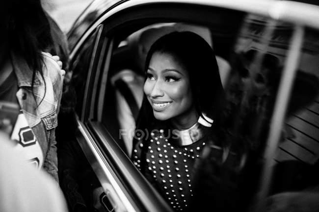 Nicki Minaj sitting in car after Balmain Show — Stock Photo