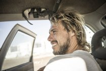 Male surfer sitting in car — Stock Photo