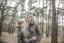 Couple laughing during woodland walk — Stock Photo