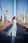Woman in Blue gown on Brooklyn bridge — Stock Photo