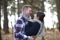 Couple embracing in forest — Stock Photo
