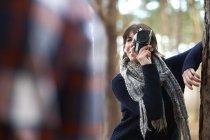Woman taking photo of man — Stock Photo