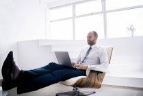 Businessman typing on laptop — Stock Photo