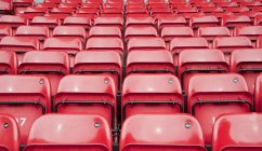 Rows of coloured seats — Stock Photo