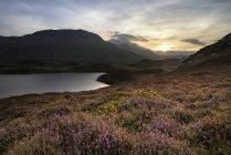 Sunrise over mountain range with lake — Stock Photo