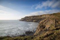 Coastal landscape with cliffs and misty glow — Stock Photo