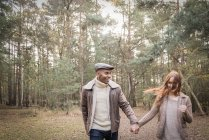 Couple having fun during forest walk — Stock Photo