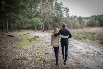 Young couple on forest walk — Stock Photo