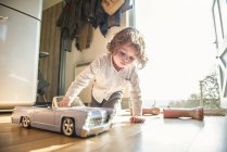 Boy playing with toy car — Stock Photo
