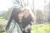 Mother and daughter in spring garden — Stock Photo