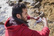 Mountaineer filling water bottle — Stock Photo