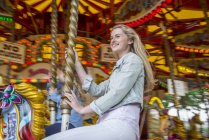 Girl riding carousel on South Bank — Stock Photo