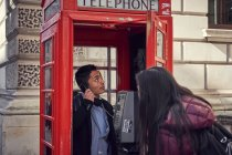 Couple make phone call whilst sightseeing — Stock Photo