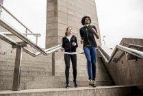 Couple limbering up before jog — Stock Photo