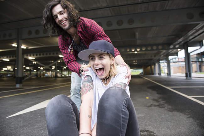 Couple having fun with skateboard — Stock Photo