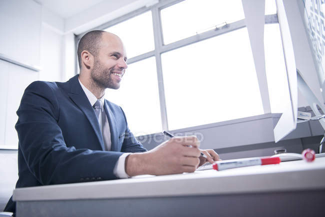 Businessman working on computer — Stock Photo