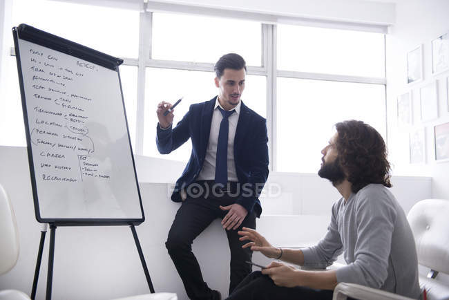 Colleagues discussing strategy — Stock Photo