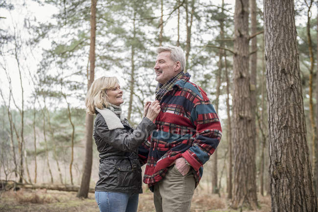 Couple enjoying walk in woods — Stock Photo