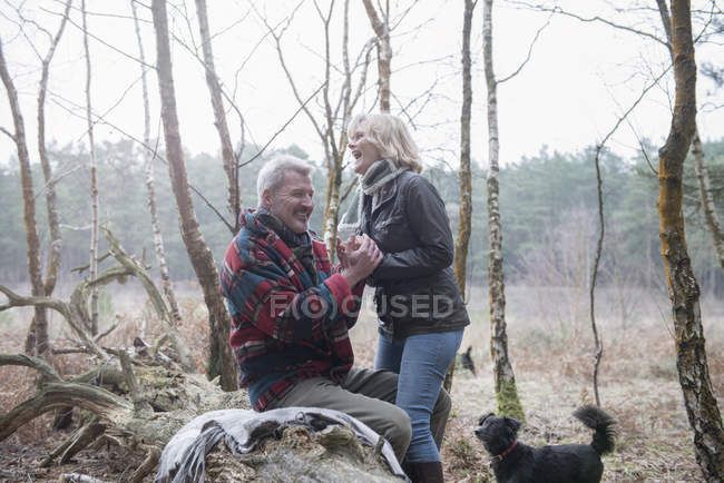 Couple enjoying break with dog — Stock Photo
