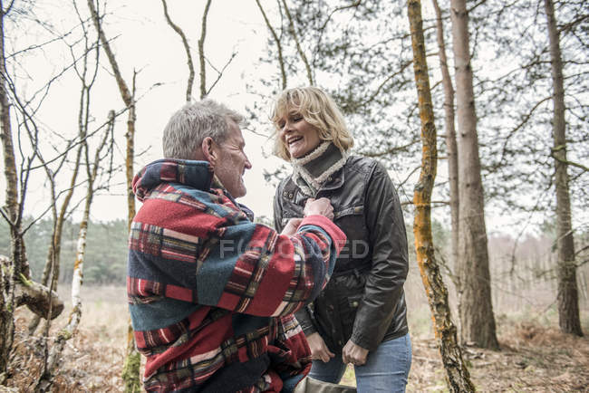 Couple having fun during woodland walk — Stock Photo