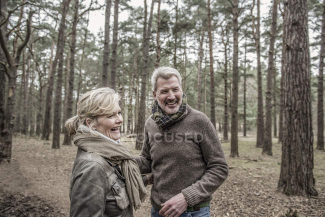 Couple laughing during woodland walk — Stock Photo