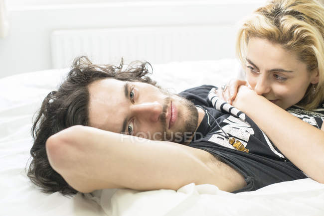 Couple in love lying in bed — Stock Photo