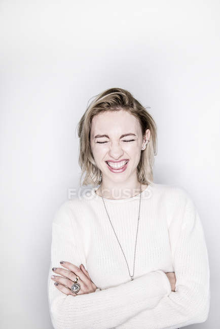 Woman laughing with closed eyes — Stock Photo