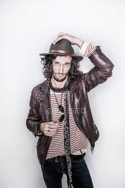 Man with long hair in leather jacket — Stock Photo