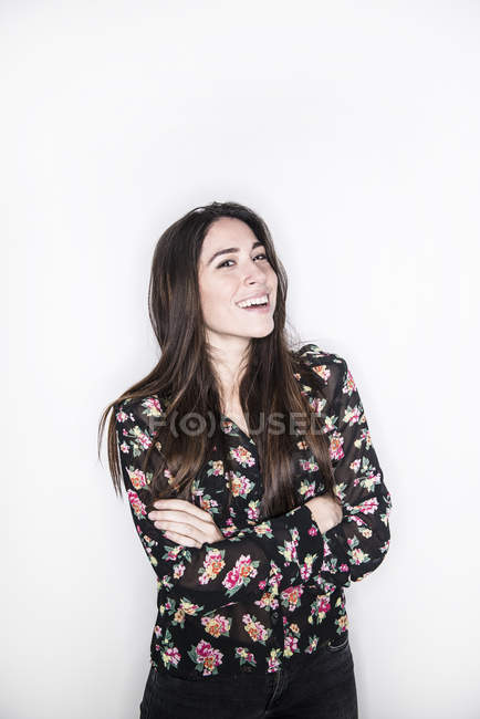 Woman standing with crossed arms — Stock Photo