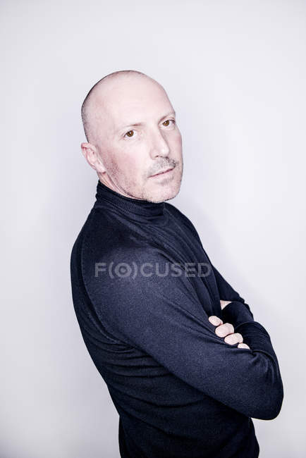 Bald man looking at camera — Stock Photo