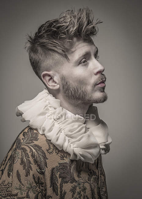 Man wearing jacket with a frilled collar — Stock Photo