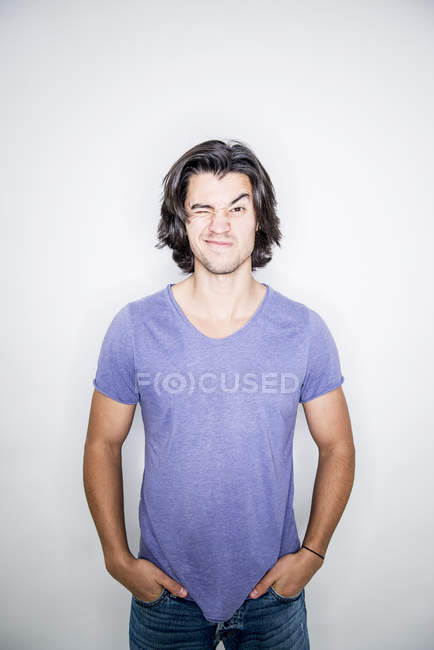 Young man posing in studio — Stock Photo