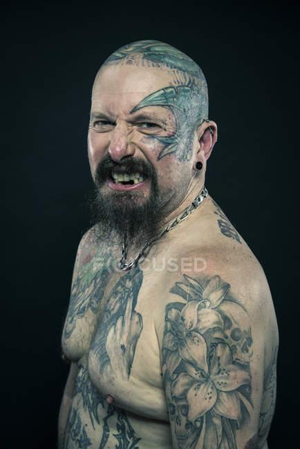 Portrait of tattooed older man — Stock Photo