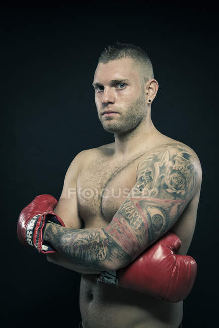 Portrait of tattooed boxer — Stock Photo