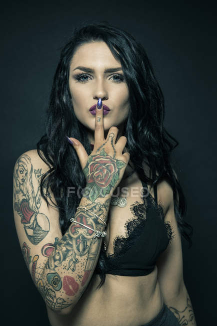 Portrait of woman with tattooed arms — Stock Photo