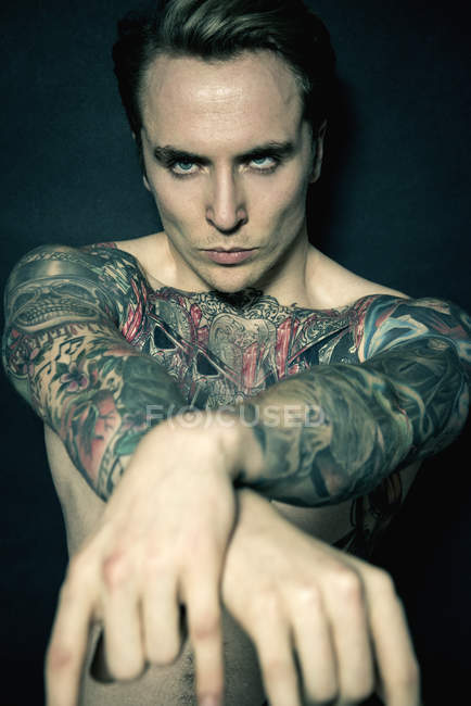 Portrait of tattooed young man — Stock Photo