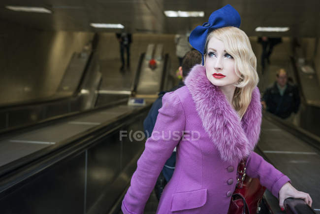 Woman on London Underground escalator — Stock Photo