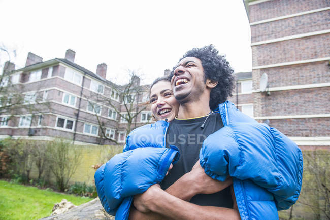 Woman hugging man from behind — Stock Photo